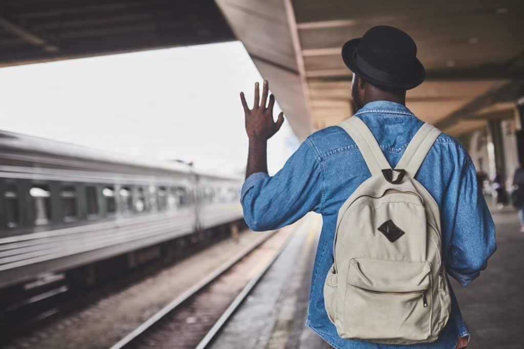 Man waving hand on the train